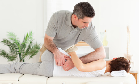 Masseur massaging a customer